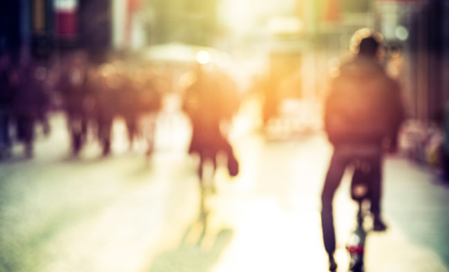 People and cyclist in the street, urban, abstract blurry