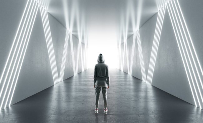 Female hacker in futuristic hallway